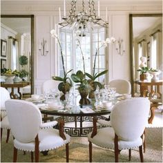 interior designer Thomas Pheasant  Nice way to use orchids at table.