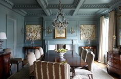lovely shade of blue offsets beautiful wood furniture in this elegant dining room // photo by Keith Scott Morton