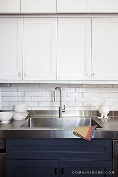 stainless steel counter, white hand-glazed subway tiles, white and navy cabinets // kitchens Narrow Kitchen, White Kitchen Cabinets, Kitchen Redo, New Kitchen, Kitchen Dining, Kitchen Remodel, Beech Kitchen, Navy Cabinets, Upper Cabinets