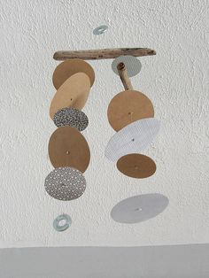 mobiles made with driftwood, recycled security envelopes, and washers.    available in my etsy shop.     GET YOUR MOBILE WEBSITES DEVELOPED BY US.  STAY AHEAD OF YOUR COMPETITORS.  http://www.itop-seo.com  support@itop-seo.com - Brought to you by http://BootcampMedia.co.uk