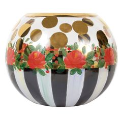This graceful glassware line certainly deserves its name. By pairing bold patterns of robust black-and-white stripes, arresting rose blossoms and splashes of gold polka dots, Heirloom Glassware will be treasured for generations to come. The Heirloom Glass Globe Vase stands out with delicate flowers, touches of gold, and robust black-and-white stripes-which upon closer inspection reveal an entire rainbow of colors. Mix a set of three-small, medium, and large-for a candle-lit entrance.