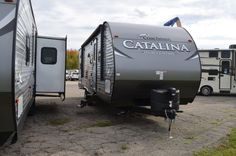 """KIDS WILL GET A KICK OUT OF THE BUNKHOUSE  2017 Coachmen Catalina Legacy Edition 293QBCK The large, rear bunkhouse in this 33' 5"""", 6,572 lb. (dry) RV gives your little campers a place to call their own in the great outdoors. The multiple bunks, COA cubes, and TV cabinet are perfect for fun sleepovers. You'll love the lovely kitchen, full bathroom, and outside kitchen with large awning! Give our Catalina Legacy Edition expert Karin Florida a call 810-834-9851 for pricing and more information. The Bunkhouse, Coachmen Rv, Little Campers, Rv Dealers, Rvs For Sale, Cubes, The Great Outdoors, Recreational Vehicles, Michigan"""