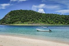 Paradise Cove island resort beach and stunning ocean with shades of blue in Fiji by Anais Photography