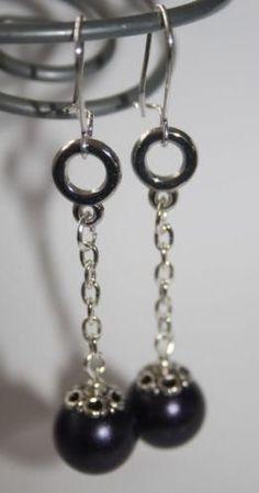 Lange oorbellen met dieppaarse parels, 1.75
