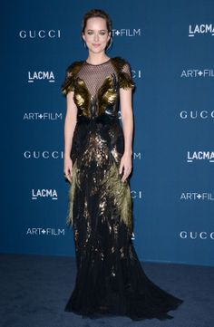 On Saturday November 2, Dakota Johnson appeared at the LACMA 2013 Art + Film gala in Los Angeles in a dress embellished with feathers from G...