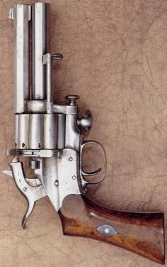 Col. Le Mat - Jean François Alexander Le Mat Støckel: born 1824 in Paris, moved 1840 to New Orleans, receives 1856 patent for his revolver where the base / cylinder pin is also used as a buckshot barrel. The revolvers started to be made 1859/1860 by Dr. Girard, Paris. V. Forgett, Alain and Marie Serpette, Le Mat, The Man, The Gun, page 162: Belgian patent Feb. 16, 1869 for Center Fire Hammer