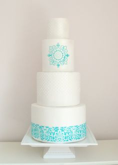 - turquoise and white pearlised wedding cake