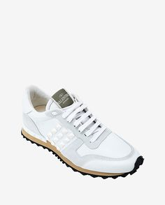Valentino Rockstud sneakers in white.