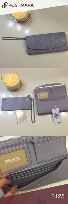 """Michael Kors wristlet/clutch/wallet Authentic Michael Kors Lilac purple Juliana large flap wallet/wristlet/clutch. Converts from a wristlet to a wallet. Saffiano leather. Inside consist of bifold wallet, removable zipper wristlet with chain strap, 10 interior slots for cards, ID window, currency compartment and outside open pocket on back. 9""""x4.5"""" NO TRADES!!!! BRAND NEW!!! Michael Kors Bags Clutches & Wristlets"""