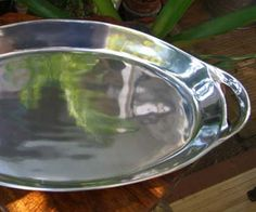 "Silver Plated Large 21"" Heavy Serving Platter with Handles $35.  Or, you can see what silver serving platters you can find on eBay.  Do you really think Pirates served food in large CorningWare pots???"