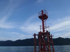 old buoy in the waters of the Golfito Dulce in Costa Rica