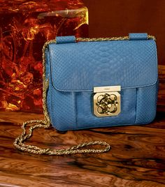 The party season is complete with our Elsie bag and its signature turn-lock