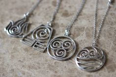 4pcs 4 Nations - antique silver Avatar the Last Airbender necklace ZH2N_S by BrandonJewelryStudio on Etsy https://www.etsy.com/listing/260358217/4pcs-4-nations-antique-silver-avatar-the