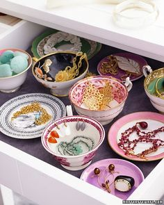 vintage teacups in a drawer to organize your jewelry