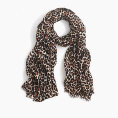 """A warm wool scarf in an exotic animal print. (Turns out leopard isn't just for that short tight dress you'll never wear again.) <ul><li>80""""L x 30""""W.</li><li>Wool.</li><li>Dry clean.</li><li>Import.</li></ul>"""