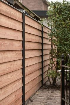 black and wood accent gate with lattice from illusions fence It feels wonderful having a beautiful patio or backyard garden, but you still need some privacy fence on your own home. That's why it's necessary to have an outdoor privacy scre Privacy Screen Outdoor, Backyard Privacy, Backyard Fences, Garden Fencing, Backyard Landscaping, Outdoor Fencing, Backyard Ideas, Privacy Fence Designs, Privacy Fences