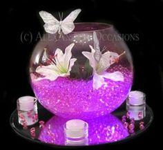 más y más manualidades: Crea bellos centros de mesa con espejos y peceras de cristal