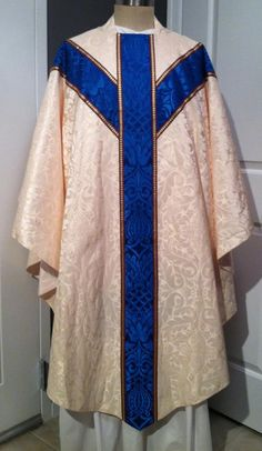 Two new sets of custom vestments, one Marian and one penitential, tailored to GH designs by Hayes and Finch, Ltd. arrived for final inspection before being sent off to the Church of the Immaculate Conception in Kenton, Ohio. The vestments are all of English brocades and finished with traditional English braids.