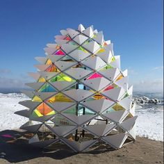 """#WinterStations is a new design competition in #Toronto, which garnered more than 200 submissions from an international open call. From Feb 16 thru March 20, five lifeguard stations lining the lake at the foot of Kew Gardens in the #Beaches are transformed into interactive art to add colour, movement & humour to the landscape. This is """"Snowcone"""" by Lily Jeon and Diana Koncan. Thanks to @silverthroat for the pic! @ www.archilovers.com"""
