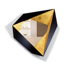 An%20origami-inspired%20lacquer%20and%20gold-leaf%20mirror.