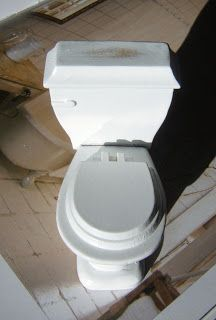 make mine mini: How to take apart a modern toilet and turn it into a Victorian one with a pull chain.