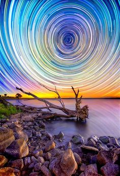 This kaleidoscope of light is actually a long-exposure shot of stars over the Australian Outback.