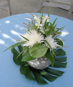 Tropical theme wedding or party centerpiece idea. Glass vase filled with sand and seashells with tropical plants Tropical Flowers, Tropical Flower Arrangements, Ikebana Flower Arrangement, Tropical Leaves, White Flowers, Tropical Wedding Centerpieces, Floral Centerpieces, Centrepieces, Centerpiece Ideas