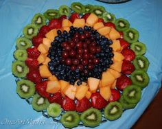 I just did this for Christmas. I put it on an oval tray and sprinkled it with blackberries...the berry that was currently on sale. This looked much better than my typical fruit tray