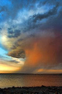 AWESOME! Sunset turns a rainstorm over Lake Eufaula in eastern Oklahoma into an awesome sight.