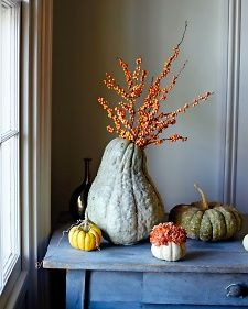 Show off the beauty of fall in the bounty of fall: Vases made from squashes and pumpkins make naturally beautiful vessels.