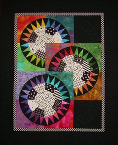 Crop Circles quilt, a New York Beauty variation.  Spotted at Nine Patch Media
