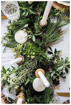 Tabletop wedding decor with green garland centerpiece | Evergreen Floral Runner  centerpiece | Grab a Cup of Cocoa and Enjoy This Cozy Winter Wedding Inspiration #winterwedding #weddings #weddingflowers #centerpiece #weddingcenterpiece #weddingdecor #weddingdecorations #floral