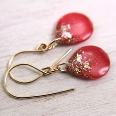 red teardrop earrings with gold flakes and glitter on 14k gold filled - red drop earrings. $21.00, via Etsy.