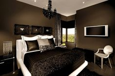 Pretty much my exact vision for my new bedroom , the contrast of the black and brown colors are breath taking. The leather pillows are everything.