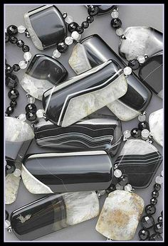 Harlequin necklace: natural showstopper. Broad slices of arrestingly unique black & white agate are hand-polished to showcase their natural flows of color & crystallization. Faceted grey jade & black onyx beads add a refined sparkle.