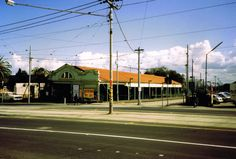 """St Kilda Railway Station before conversion to light rail in 1987.  It looked very run down then, now it is beautifully restored with shops inside.  The light rail platform now lies adjacent, it connects with the Fitzroy Street tram line and the service continues to Acland Street.  When the heavy rail line closed there was graffiti """"THANKS FOR MAKING MY STUMPS BLEED"""" which existed for years after."""