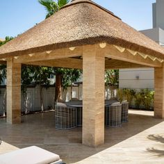 One of our favourite looks! A beautiful small thatched gazebo on concrete columns in our natural timber finish.  #thatch #thatching #thatchedroof #gazebo #thatchedgazebo #timber #natural #outdoors #outdoorliving #outdoorseating #summer #home #villa #exterior #design #homedesign #beautiful #capereed #dubai