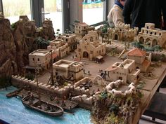 an amazing pirate port. Fantasy Town, Christmas Nativity Scene, Wargaming Terrain, D&d Dungeons And Dragons, Free To Use Images, Paper Crafts Origami, Model Train Layouts, Fantasy Miniatures, Tabletop Rpg