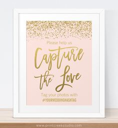 Blush pink and gold glitter capture the love wedding hashtag sign.