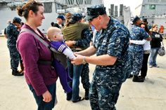 U.S. Navy Petty Officer 2nd Class Mark Parlin plays with his son before the USS Anzio departs Naval Station Norfolk, Va., May 11, 2011. Parline is a cryptologic technician assigned to the Anzio, deploying as part of the George H.W. Bush Carrier Strike Group to support maritime security operations in the U.S. 5th and 6th Fleet areas of responsibility. Photo by Petty Officer 2nd Class Rafael Martie.  #MilitaryFamilyLove