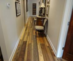 office hallway. Old Dirty Goat reclaimed heart pine flooring. rustic, character. Prefinished, zero-VOC penetrating oil finish. Wide planks, random widths