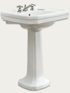The stepped basin, sweeping pedestal, and bright chrome faucet on this vitreous-china sink replicate the luxurious look of a 1930s Art Deco bathroom. $435; DEA Bathroom Machineries