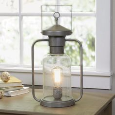 Sleek yet artful, this lantern casts even the coolest spaces in a warm  glow.