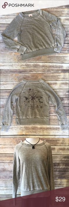 """Roxy Fleece Lined Sweater Roxy fleece lined sweater with a compass graphic on the back. Measures from pit to pit 17""""/ length 24"""". No inside tag so I don't know the material content but it's so soft! Roxy Sweaters"""