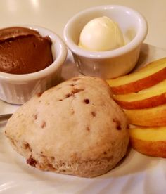 """A little """"ooh la la"""" to start off breakfast with our homemade butter toffee scones, fresh raw sugar peach slices and French chocolate cocoa frosting for dipping."""