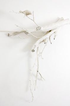 Painted white branches- can hang items off them or use purely as decoration next to the giraffe