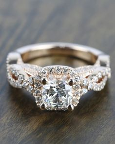 A beautiful Cross Split-Shank Cushion Halo Engagement Ring in Rose Gold!