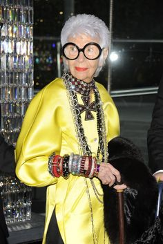 """Iris Apfel in her signature & latest accessory sponsorship.  From clothing, jewelry, decor, it's a natural segue for Apfel since one of her signature accessories are over sized round frame glasses. Her collection for eyebobs includes a special, limited edition """"Iris"""" frame which will bow in January 2012.  On my wish list...maybe for sunglasses?"""