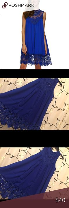 🎄Rich and Royal Blue Holiday Dress Rich and Royal blue dress. Perfect for that cocktail party or celebration! Lace accent on chest and skirt bottom! 34 inches from shoulder to hem! Beautiful blue lining underneath and A-line dress that flatters all body types. Absolutely love love dresses! So easy to look glamorous in easy to go fashion! Dresses