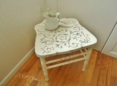 Backless chair as a side table or stool.  Painted, distressed with a scrolling stencil.  Cute!